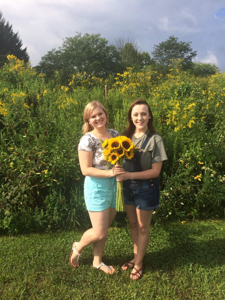 Madeline and Mikayla with sunflowers